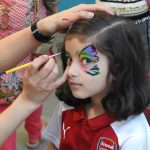 Young visitor Safah Afzal Jahangir enjoys face painting