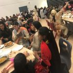 Family and students enjoy the meal